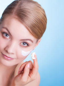 Skincare. Face of young woman girl taking care of skin following a chemical peel